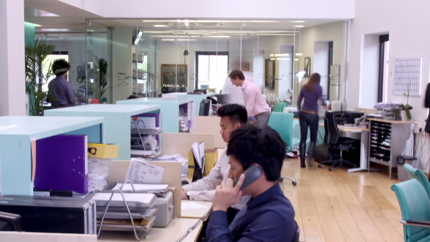 Time lapse shot of a young and attractive business team of mixed ethnicity, working together in a busy contemporary office. | Shutterstock HD Video #4391150