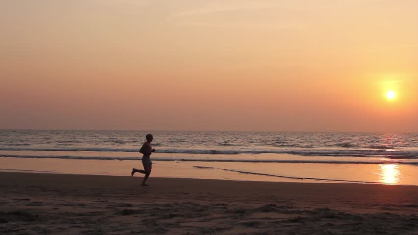 Young man workout on the beach. Training. India. Goa - HD stock footage clip
