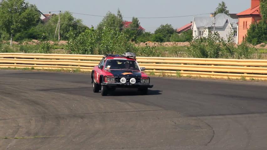 KIEV, UKRAINE - JUNE 22: International Rally Peking to Paris 2013. Red sport-looking vintage car Mercedes 450 SLC in international racing - HD stock footage clip