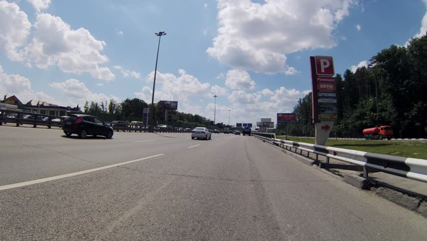 Driving on highway during the day, timelapse - HD stock video clip
