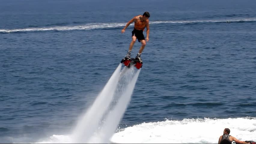 "ALICANTE, SPAIN – AUGUST 04: The ""Flyboard"" is a new sport for lovers of water sports. His spectacular amazes all swimmers.; Spain; on august 04, 2013 in Alicante."