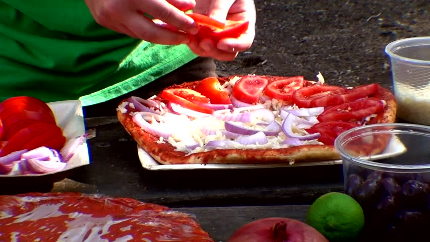 making hand made pizza with olives and tomatoes on wooden table on picnic 1920x1080 intro motion slow hidef hd 1080p