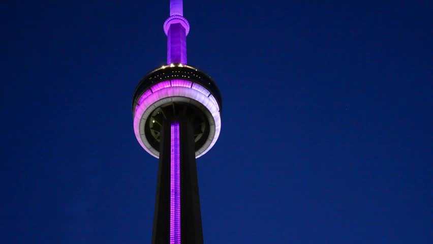 TORONTO - AUGUST 9: CN Tower is one of the highest structures, the tallest free standing construction in the world and a Canadian tourist landmark as shown on August 9, 2013 in Toronto, Canada