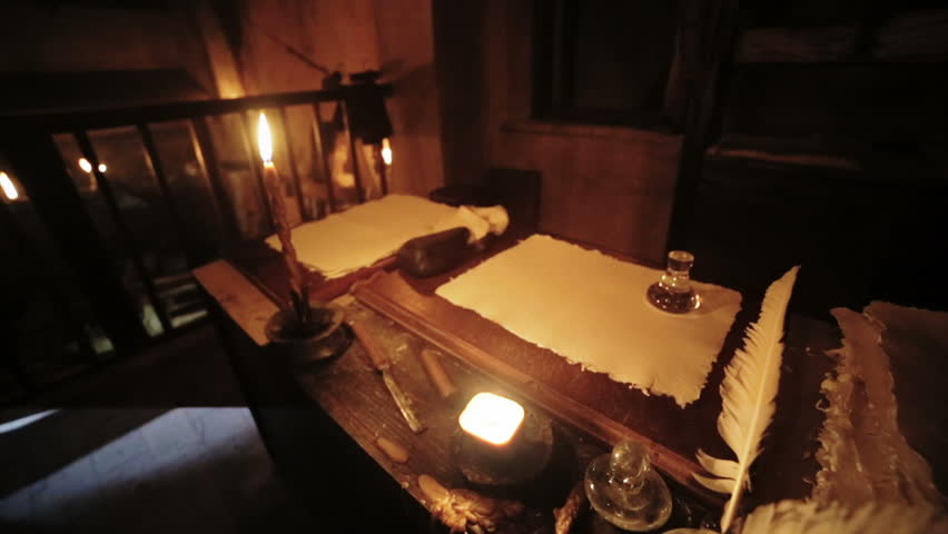 Book, pen, candle in a old medieval scriptorium