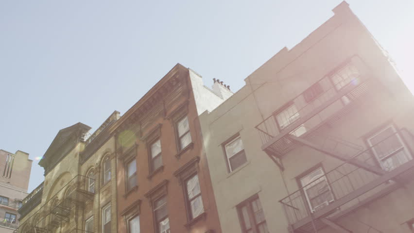 Low angle view of buildings in a residential area of New York on a bright sunny day. #4435286