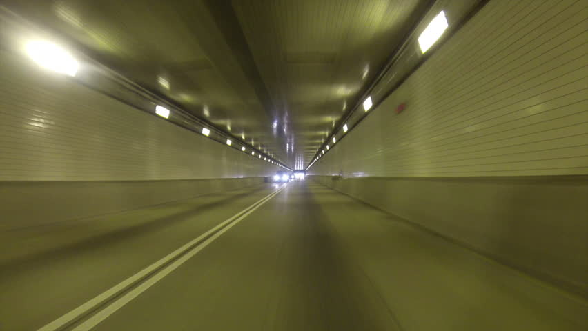 A rear view perspective of driving into the Fort Pitt Tunnel in Pittsburgh,
