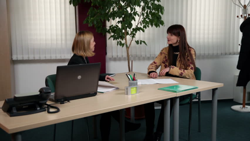 Wide shot of CEO explaining about new job to interviewee - HD stock video clip