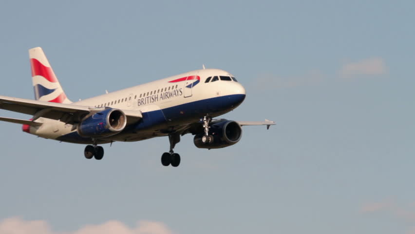 MANCHESTER, LANCASHIRE/ENGLAND - JULY 26: British Airways plane airbus A319 coming in to land on July 26, 2013 in Manchester. British Airways is a founding member of Oneworld airline alliance.