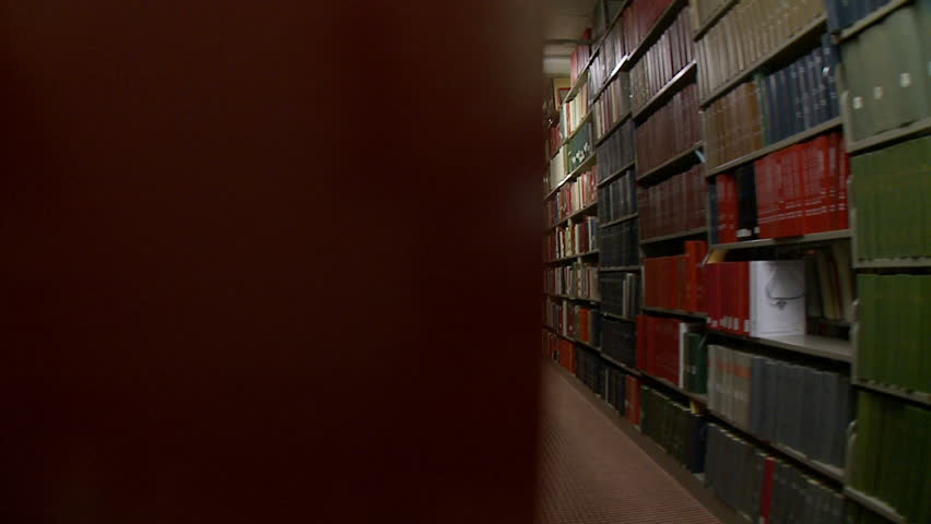 Tracking past library shelves in a seamless, endless slow motion loop.