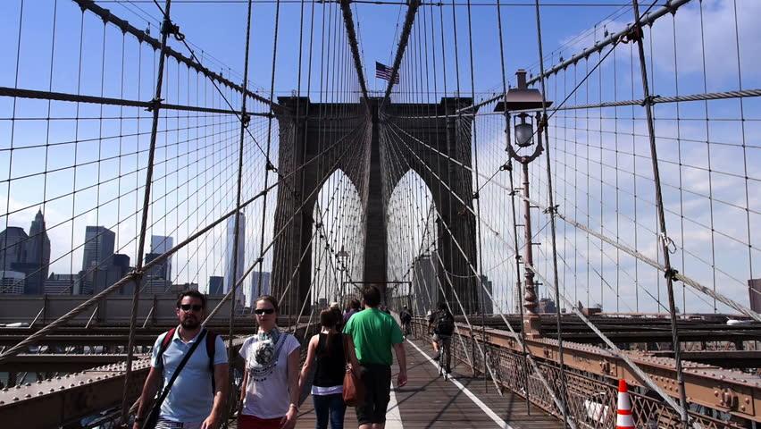 NEW YORK CITY, Circa August, 2013 - Pedestrians walk over the Brooklyn Bridge.