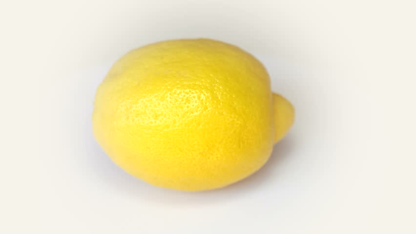 Lemon rotating on white background - HD stock video clip