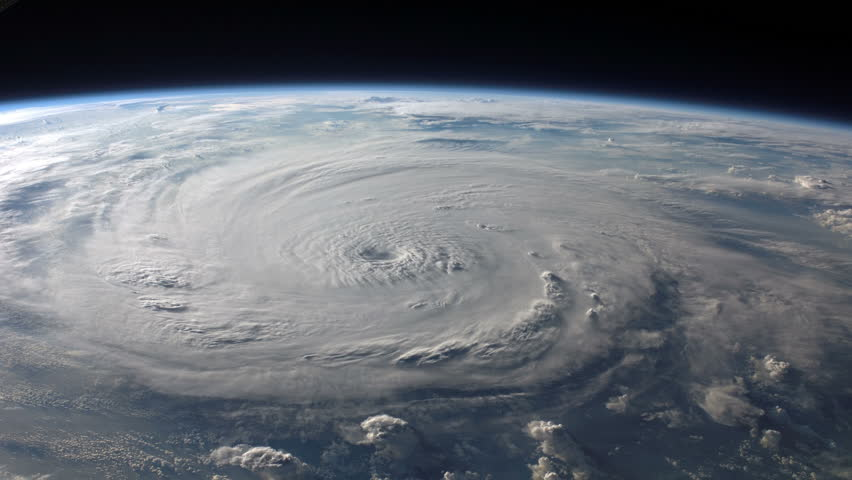 Satellite view of a large hurricane / typhoon with a well defined eye. | Shutterstock HD Video #4475606