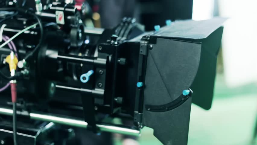 A professional film camera on a green screen hollywood sound stage.