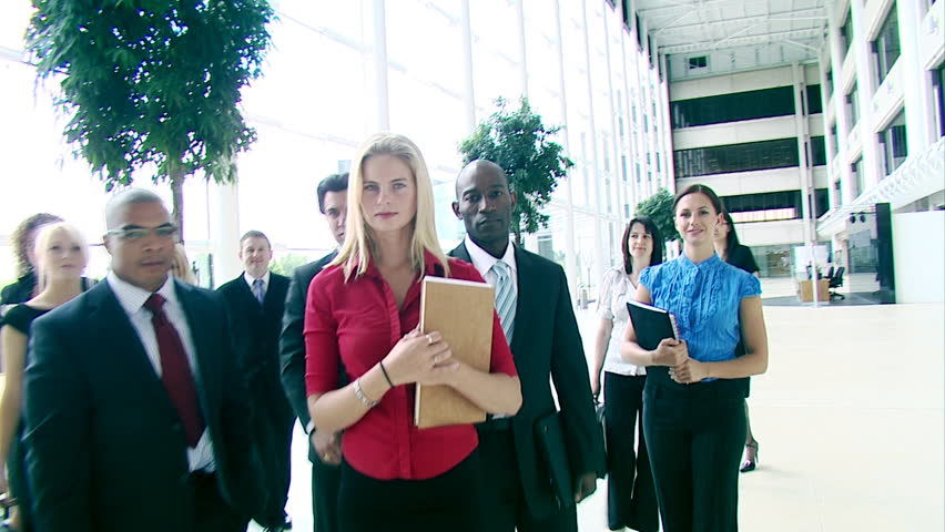 Unique steadicam shot of busy working office. Multiple actors in business pose.<br>High quality HD video footage - HD stock video clip