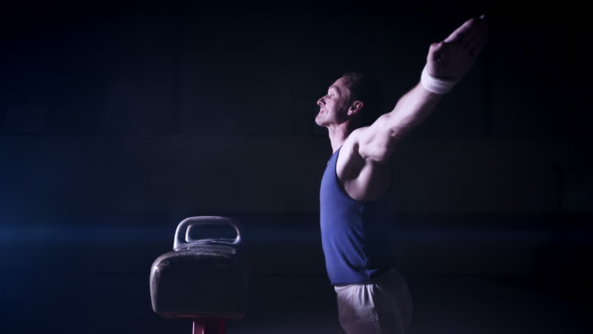 Male gymnast mounting and dismounting pommel horse. Olympics sport in contemporary setting. Slow motion Shot on RED Epic at 240FPS