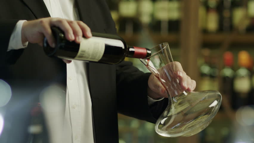 Sommelier Pouring Red Wine into Decanter. Shot on RED Digital Cinema Camera in 4K (ultra-high definition (UHD)), so you can easily crop, rotate and zoom, without losing quality!