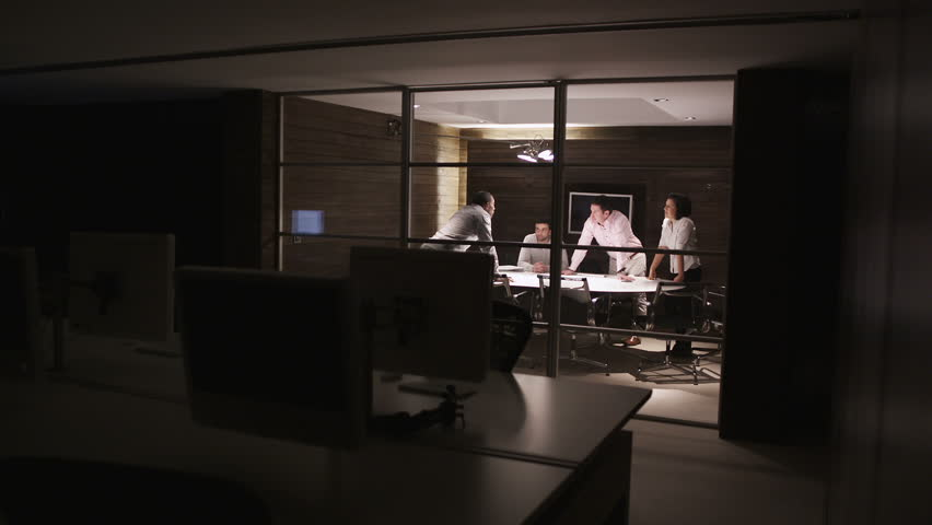 Contemporary small creative business working late through the night.  Casual young people in architecture company.