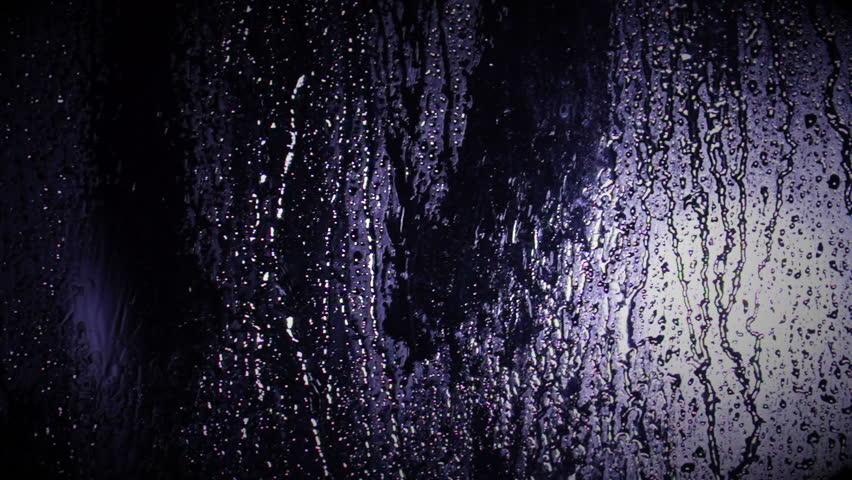 Rain On A Window Pane At Night With Reflecting Light ...