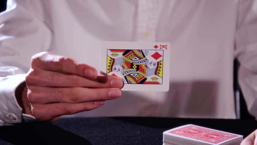 Poker fly magic trick
