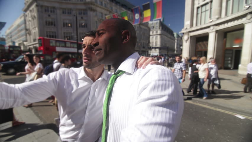 Two friends or business colleagues in central London | Shutterstock HD Video #4534412