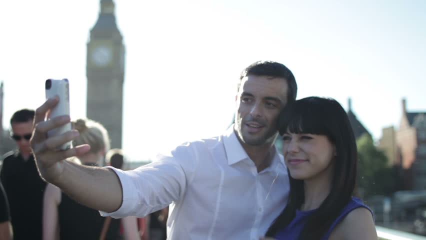 Couple on holiday in London take photo of themselves