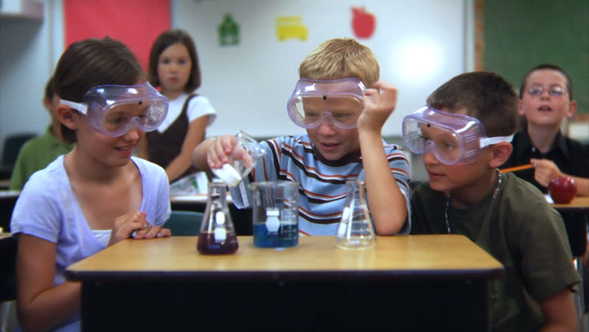 Elementary school students doing a science experiment | Shutterstock HD Video #4541198