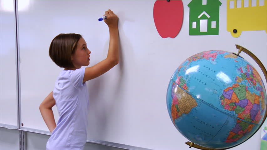 School student doing a math problem on white board | Shutterstock HD Video #4541252
