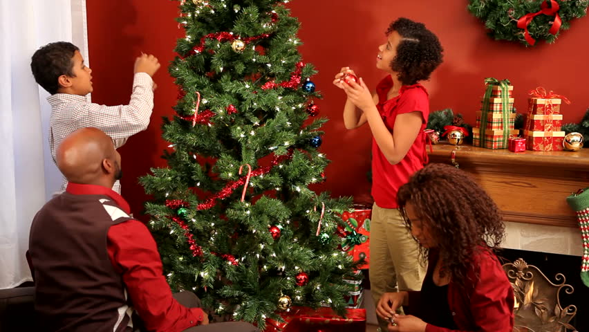 Family decorating Christmas tree together #4551548
