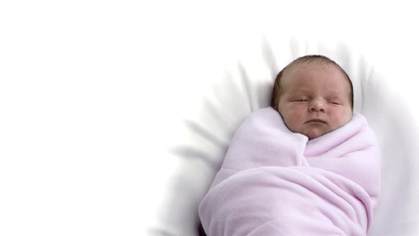 A baby all wrapped up in a pink blanket. - HD stock footage clip