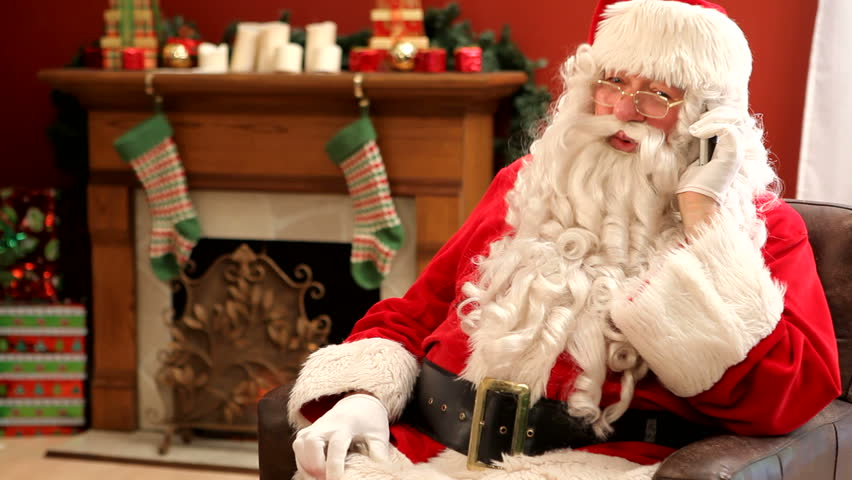 Santa Claus talking on cell phone - HD stock video clip