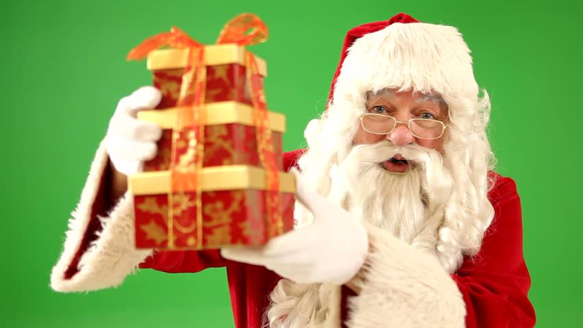 Santa Claus holding up Christmas gift - HD stock footage clip