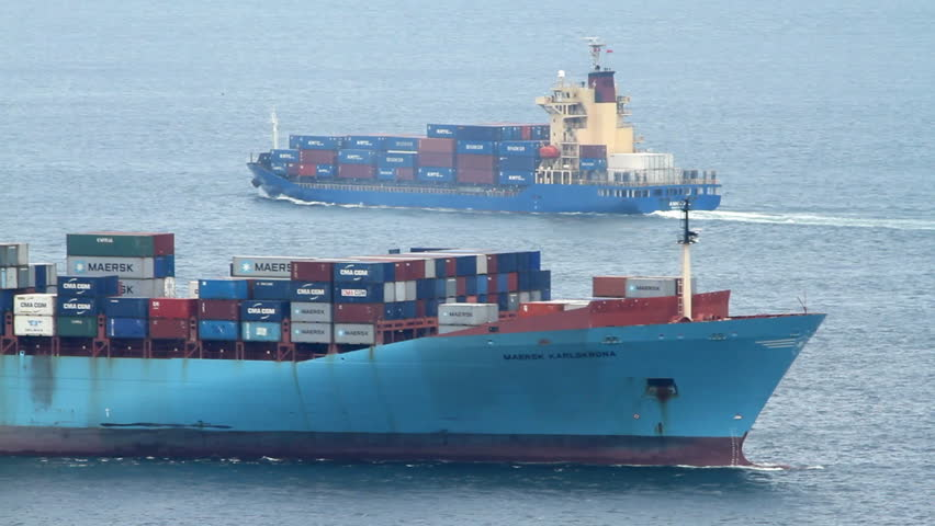 HONG KONG - JULY 19: Cargo Container Ships Passing on July 19, 2013 in Hong