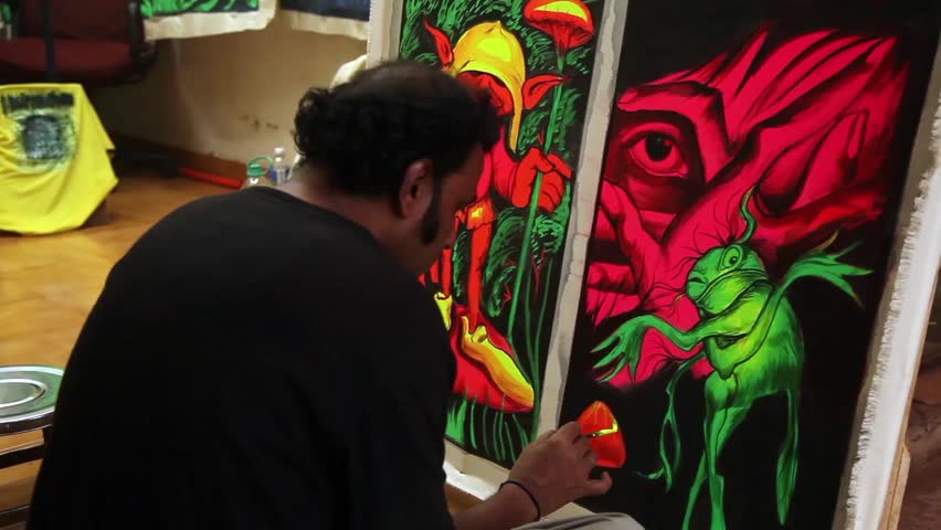 INDIA, GOA, 2 JANUARY: Painter in market of arambol. He Sit on the street and work.  Fluorescent art. - HD stock video clip