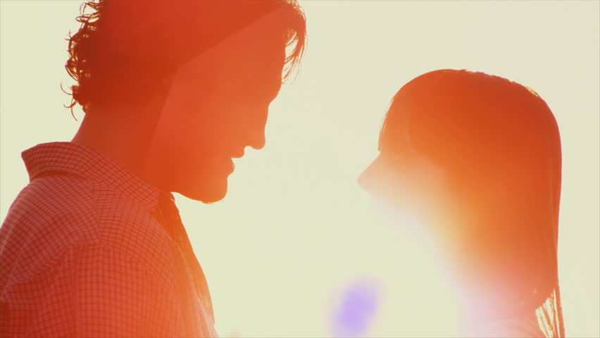 Beautiful Young Couple in Love kiss in the sun | Shutterstock HD Video #4580033