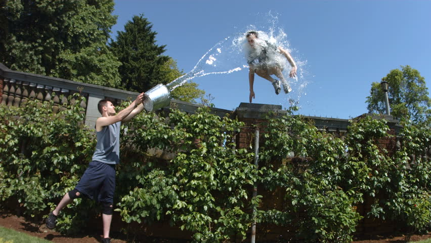 Free runner jumps through bucket of water