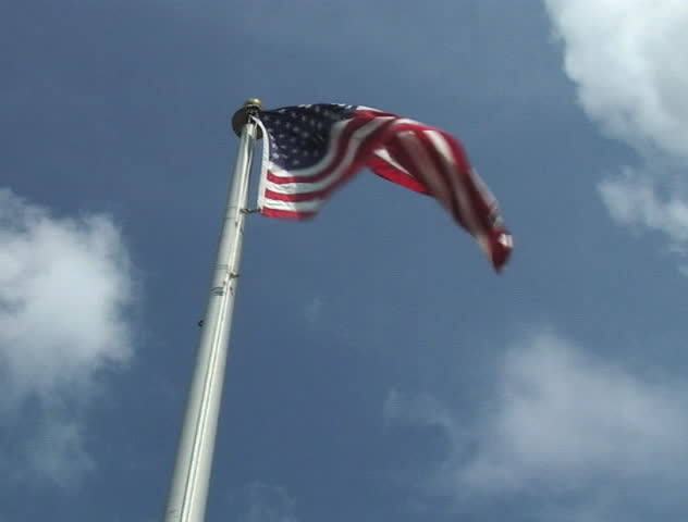 American flag flying in wind with clouds in sky moving behind it (2:3:3:2 pulldown) - SD stock footage clip