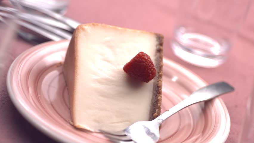 Raspberries falling onto cheesecake, slow motion #4620380