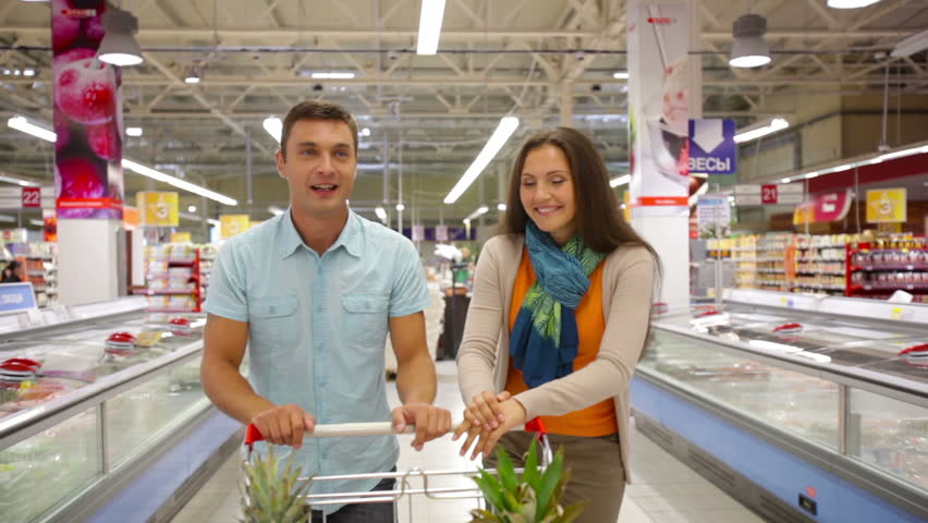 Cheerful couple spending their weekend doing shopping together