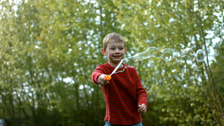Young boy making bubbles, slow motion - HD stock footage clip