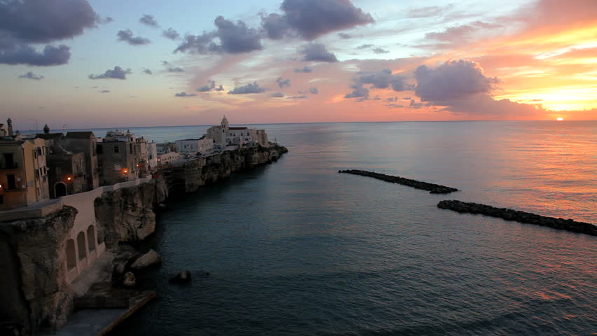 Scenic view of Vieste town on the rocky Pizzomunno promontory at sunrise in Puglia, Italy | Shutterstock HD Video #4642025