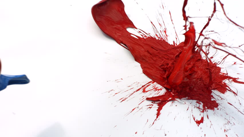 Red and blue paint splattering on white background