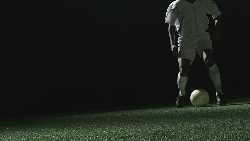Close up of a soccer player jumping over a sliding defender - HD stock footage clip