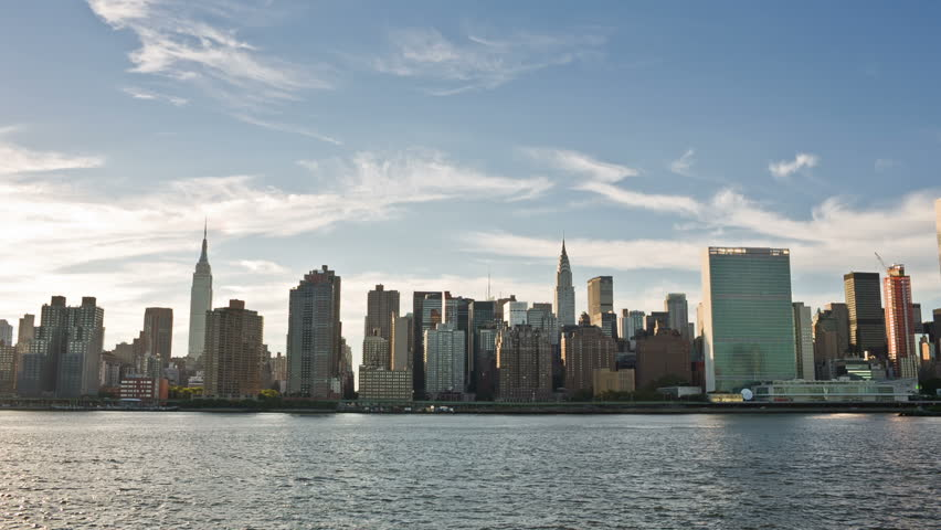NEW YORK - SEPTEMBER 9, 2013: famous Skyline with Empire State Building, UN, and East River in NYC. Manhattan is the most densely populated borough in the city. | Shutterstock HD Video #4652375