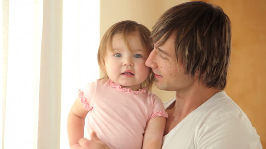 Portrait of father and young daughter