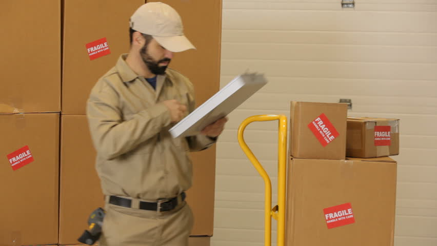 Delivery man delivers packages through warehouse