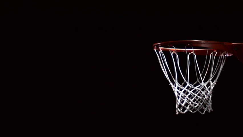 Close up of a basketball going through the net for a field goal.