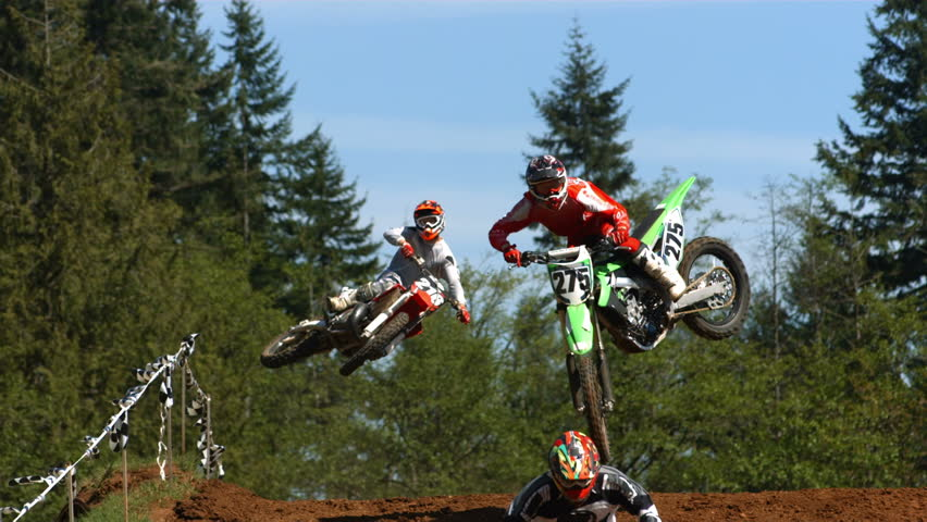 Motorcross racers jumping  - HD stock footage clip