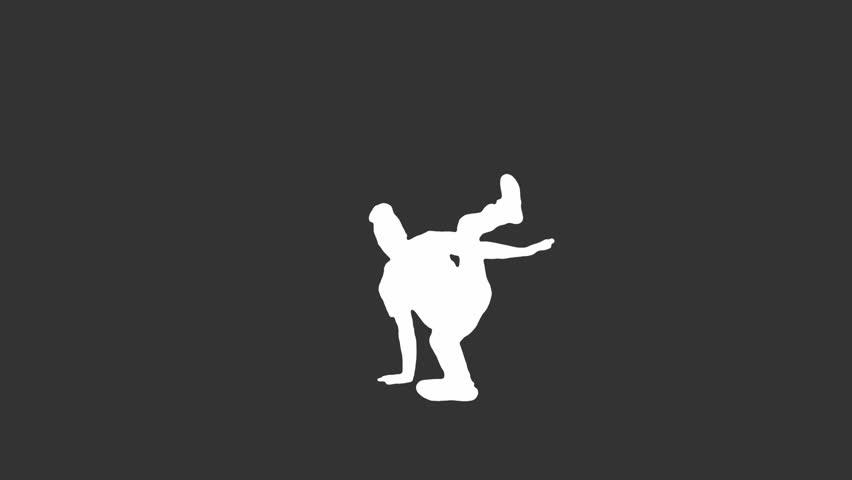 A break dancer spins and twirls on a black background. Medium shot.