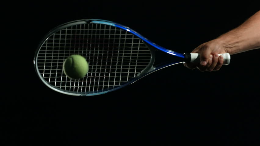 Tennis Ball being hit in slow motion against black background | Shutterstock HD Video #4665011