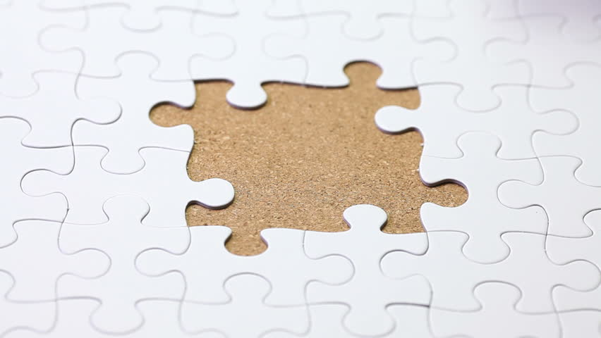 Solving A Jigsaw Puzzle Game Stock Footage Video 4669259 ...
